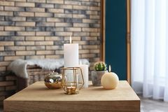 Burning candles on table indoors. Interior decor element stock photography