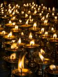 Burning candles in a Temple Royalty Free Stock Images