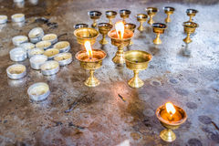Burning candles in temple Royalty Free Stock Photography
