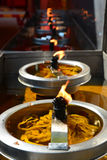 Burning candles. In temple, the Use of Candles in Buddhism Stock Images