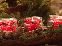Burning candles. Three burning red candels - christmas deco Royalty Free Stock Photography