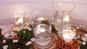 Burning candles in water glass stock footage
