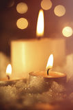 Burning candles in wet snow Royalty Free Stock Images
