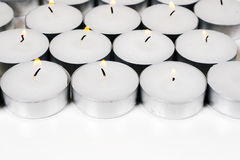 Burning candles on a white background Royalty Free Stock Images