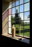 Burning candles in a window Stock Image