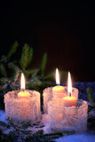Burning candles on a winter background Stock Photography