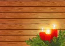Burning candles on a wooden background. cosiness. Stock Photos