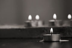 Burning candles, wooden background Royalty Free Stock Photos