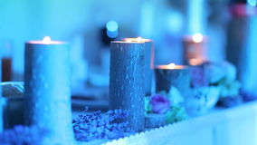 Burning candles on wooden stumps at the wedding table. stock footage