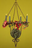 Burning candlestick 1. Burning candlestick with fall decoration and a green background Stock Images
