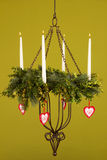 Burning candlestick 2. Burning candlestick with Christmas decoration and a green background Royalty Free Stock Image