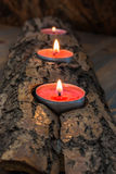 Burning candlestick. Burning candle holder made from the bark of the tree. Beautiful and unique decoration in your home Stock Photography