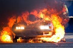 Burning car. Burning old car at auto show Stock Photo