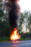 Burning car. The car is burning on the roadway Stock Image