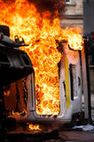 Burning car. car destroyed and set on fire during the riots. city center Royalty Free Stock Images