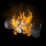 Burning car chassis with engine and wheels Royalty Free Stock Photo