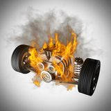 Burning car chassis with engine and wheels Stock Images
