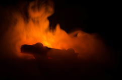 Burning car on a dark background. Car catching fire, after act of vandalism or road indicent Stock Photos