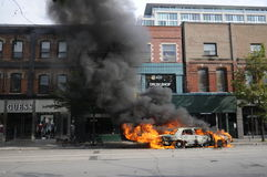 Burning car in downtown Toronto. stock photo