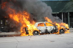 Burning car in downtown Toronto. stock photos