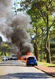 Burning car on the road royalty free stock photos