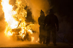 Burning car on the road Stock Photo