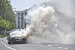 Burning Car on the street Royalty Free Stock Photography