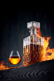 Burning carafe and glass of whiskey Royalty Free Stock Photo