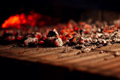 Burning carbon. Close up of hot burning wood under the bbq grill Stock Images
