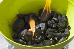 Burning carbon. In a green barbeque, close up of fire Stock Images
