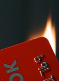 Burning card. Close-up of burning plastic card Stock Photo