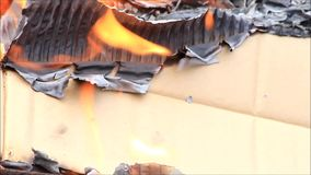 Burning cardboard stock video