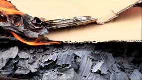Burning cardboard, close up stock footage