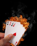 Burning cards Stock Image