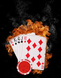 Burning cards. Flaming poker cards triumph, isolated on black background Royalty Free Stock Images