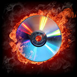 Burning CD. Isolated on black background Stock Photo