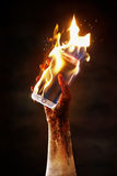 Burning cell phone Stock Images