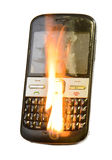 Burning cellphone. Picture of burning modern smartphone Stock Photo