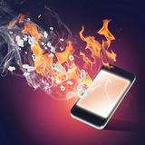 Burning cellphone Royalty Free Stock Photography