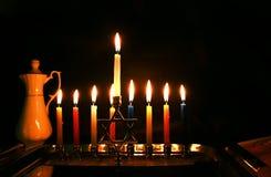 Burning Chanukah. The lit Chanukiah. Jewish holiday Hanukkah. Porcelain jug with oil. Burning Chanukah. The lit Chanukiah. Jewish holiday Hanukkah. Porcelain stock photo