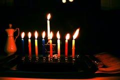 Burning Chanukah. The lit Chanukiah. Jewish holiday Hanukkah. Porcelain jug with oil. Burning Chanukah. The lit Chanukiah. Jewish holiday Hanukkah. Porcelain stock photos