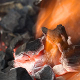 Burning Charcoal. With orange-colored flame and glow (Selective Focus, Focus on parts of the charcoal pieces around the flame Royalty Free Stock Images