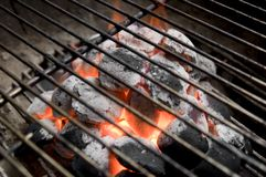 Burning Charcoal. Burning coals in barbecue grill Royalty Free Stock Photography