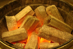 Burning charcoal. The wooden carbon is burning in the brazier Royalty Free Stock Photography