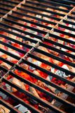 Burning Charcoal and BBQ Grill. Burning charcoal in barbecue and glowing empty grill Royalty Free Stock Photos