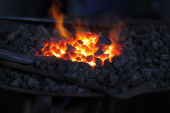 Burning charcoal at blacksmiths Stock Photography