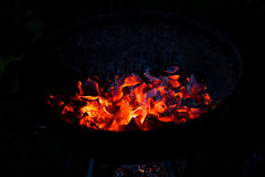 Burning charcoal in the dark Stock Image