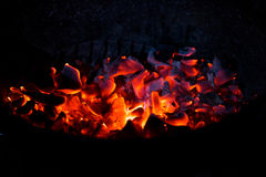 Burning charcoal in the dark Stock Photography