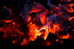 Burning charcoal in the dark Royalty Free Stock Photos