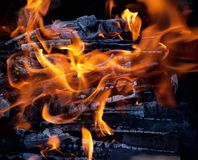 Burning charcoal embers firewood with ashes and Royalty Free Stock Image